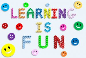 Learning is Fun spelled out with smiley faces