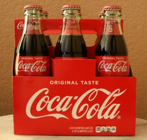 photograph of a container of bottles of Coca-Cola with the logo on the side