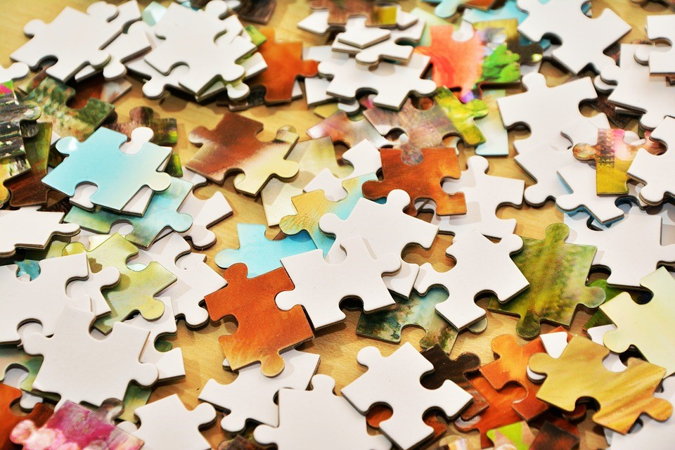 puzzle pieces on a table, unassembled
