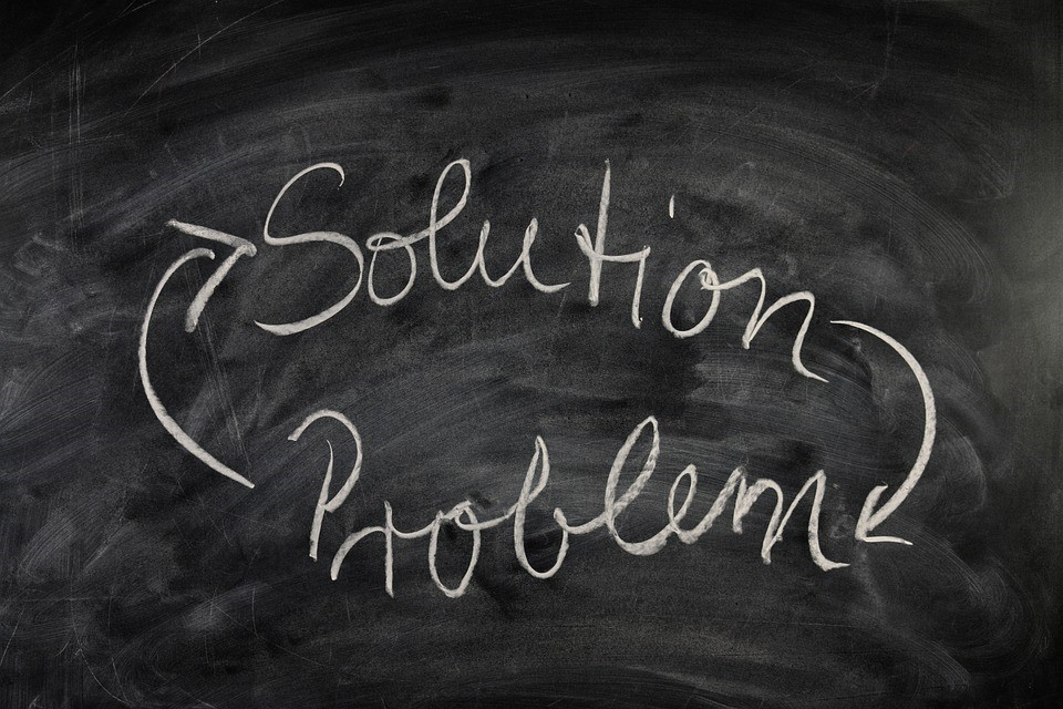 solution and problem written on a chalkboard with lines going to and from each other