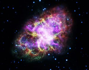 Multi-colored Crab Nebula surrounded by distant stars