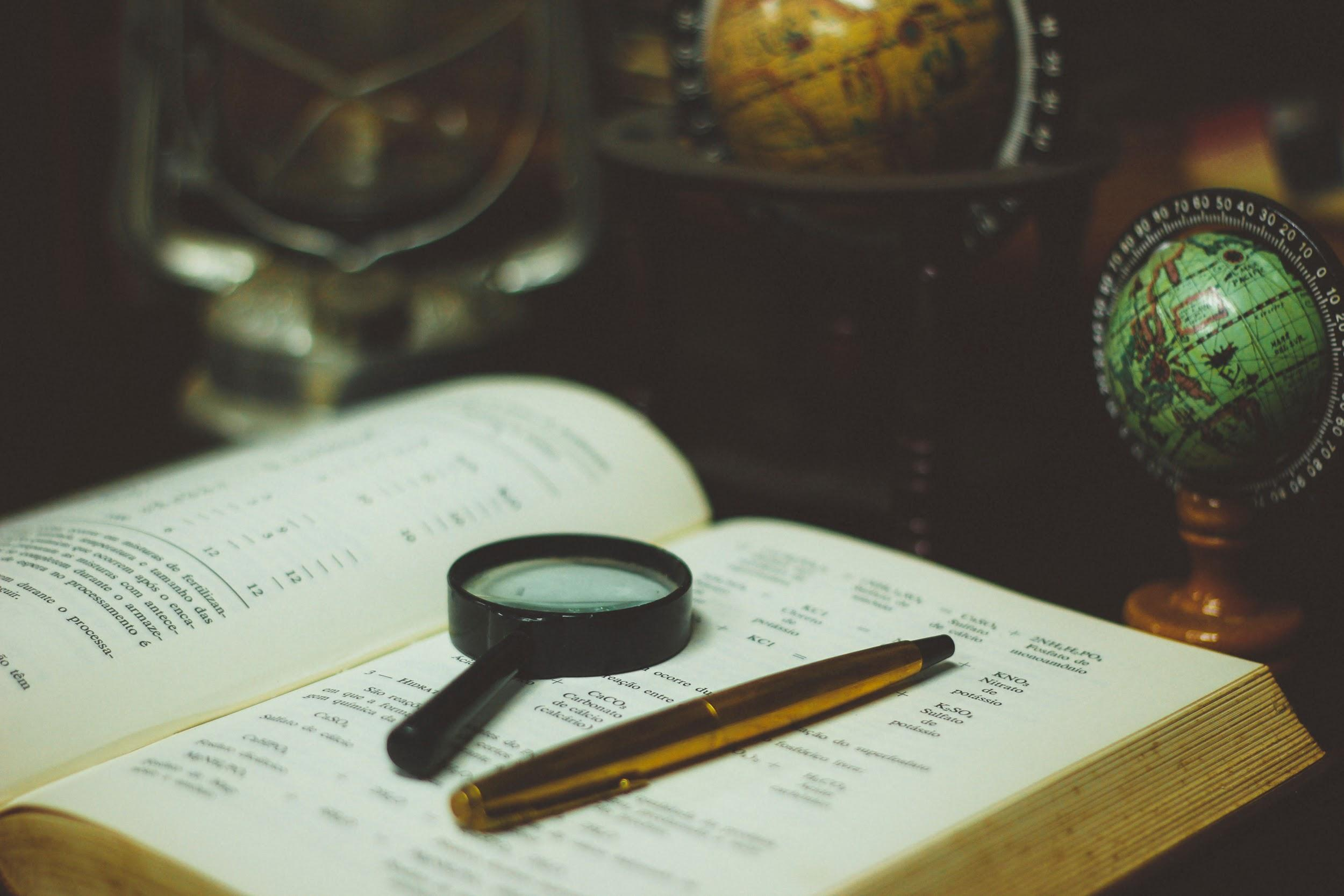 Globe, magnifying glass, and map book