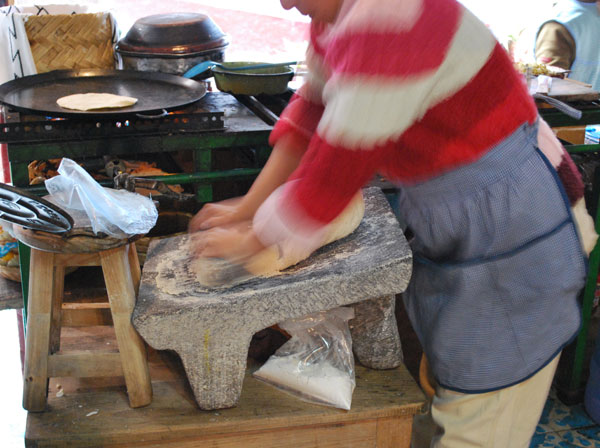 Image of Woman Grinding Corn with a Metate