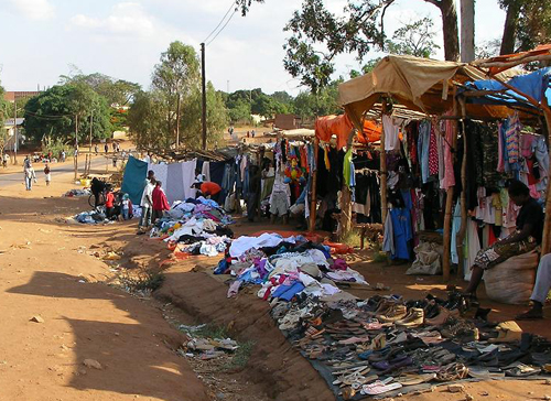 Image of a roadside stand in Zambia where used clothing is sold
