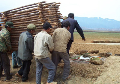 Na men carry a wooden structure to be used at a funeral