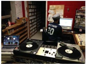 Harrison at work hosting an underground hip hop radio show.