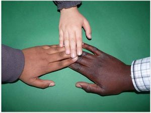 Image of hands: Human skin color ranges from dark brown to light pink