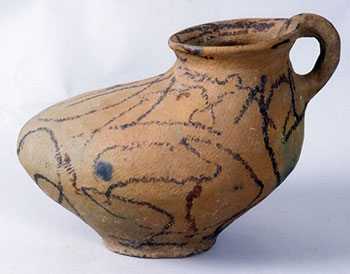 Image of a culinary shoe pot used for cooking beans