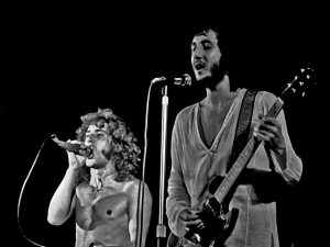 A black and white photo of The Who performing live (1972)