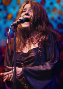 Color photo of Janis Joplin performing live (1969)