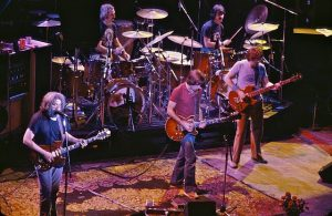 Color photo of The Grateful Dead performing live at the Warfield.