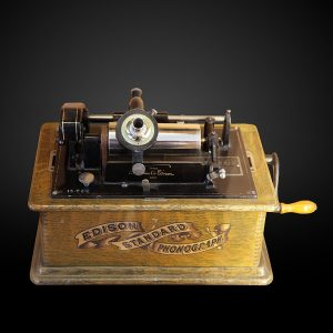 Edison's wax cylinder phonograph.