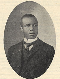 Black and white image of Scott Joplin wearing a tie.