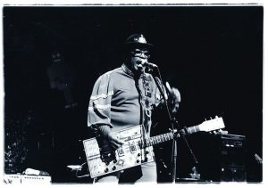 Bo Diddley on guitar.