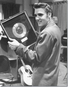 Elvis Presley with award.