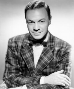 Photographic image of Alan Freed wearing plaid jacket and a bow tie.