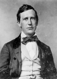 Black and white image of Stephen Foster wearing a suit and bow tie.