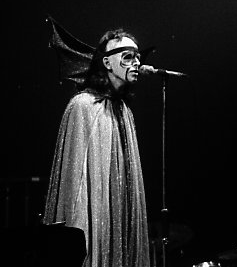 Black and white photo of Genesis performing live