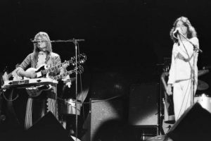 Black and white photo of two members from Yes performing live