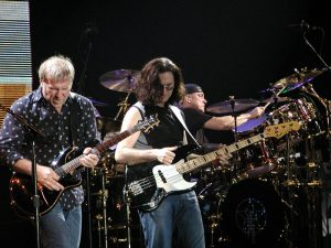 Color photo of Rush performing live