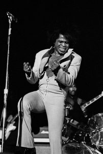 Black and white photo of James Brown performing live in Hamburg 1973
