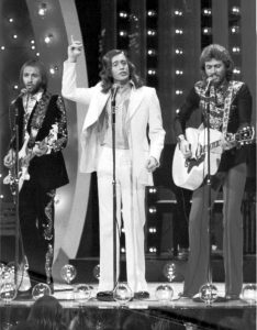 Black and white photo of the Bee Gees performing live in 1973