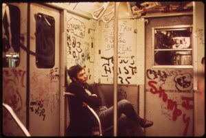 Color photo of graffiti in a New York subway car