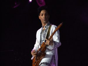 Photographic image of Prince performing.