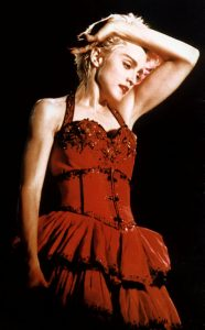 Madonna wearing a bright red dress.