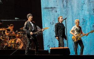 Color photo of U2 performing live.