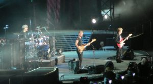 Color photo of the Police performing live.
