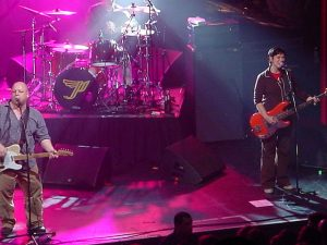 Color photo of The Pixies live.