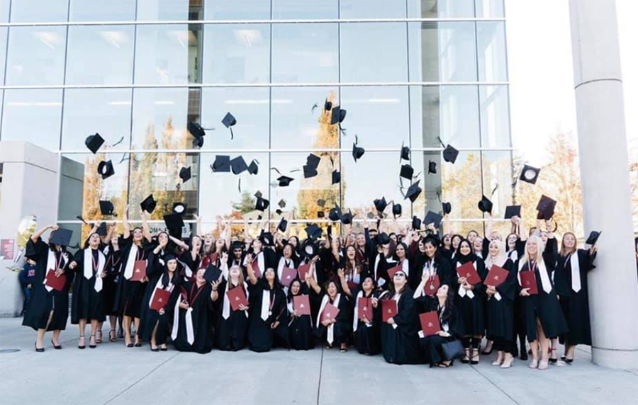 """<img src=""""UniversityTransitions.png"""" alt=""""A large group of students in their graduation gowns throwing their mortarboards in the air"""">"""