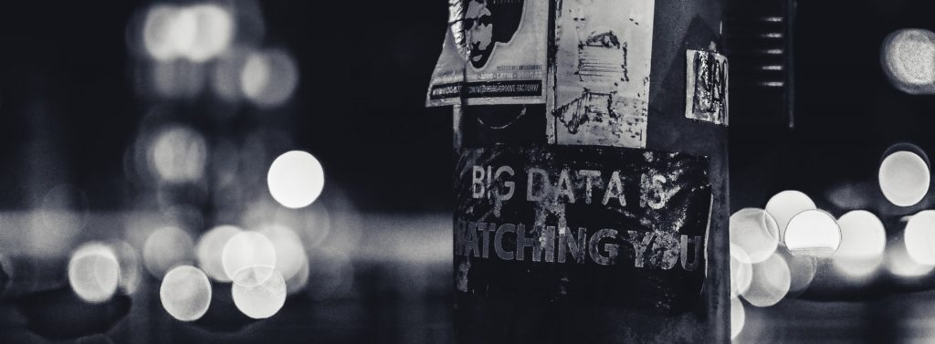 """A sign on a street lamp says """"Big data is watching you"""""""