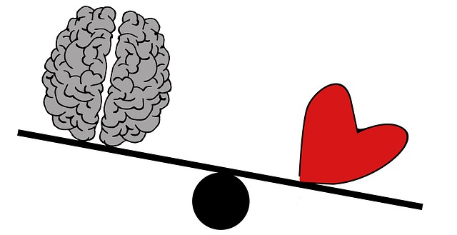 Illustration of a heart outweighing a brain on a scale