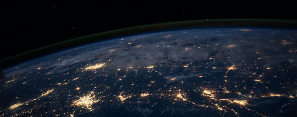 Earth from space, with lit up, networked cities