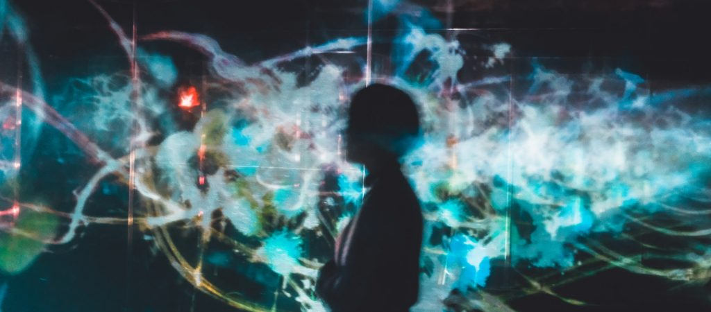 Silhouette of a person with bright digital backdrop