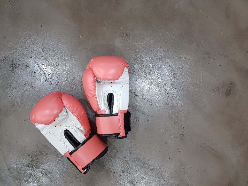 Boxing gloves sit on the floor