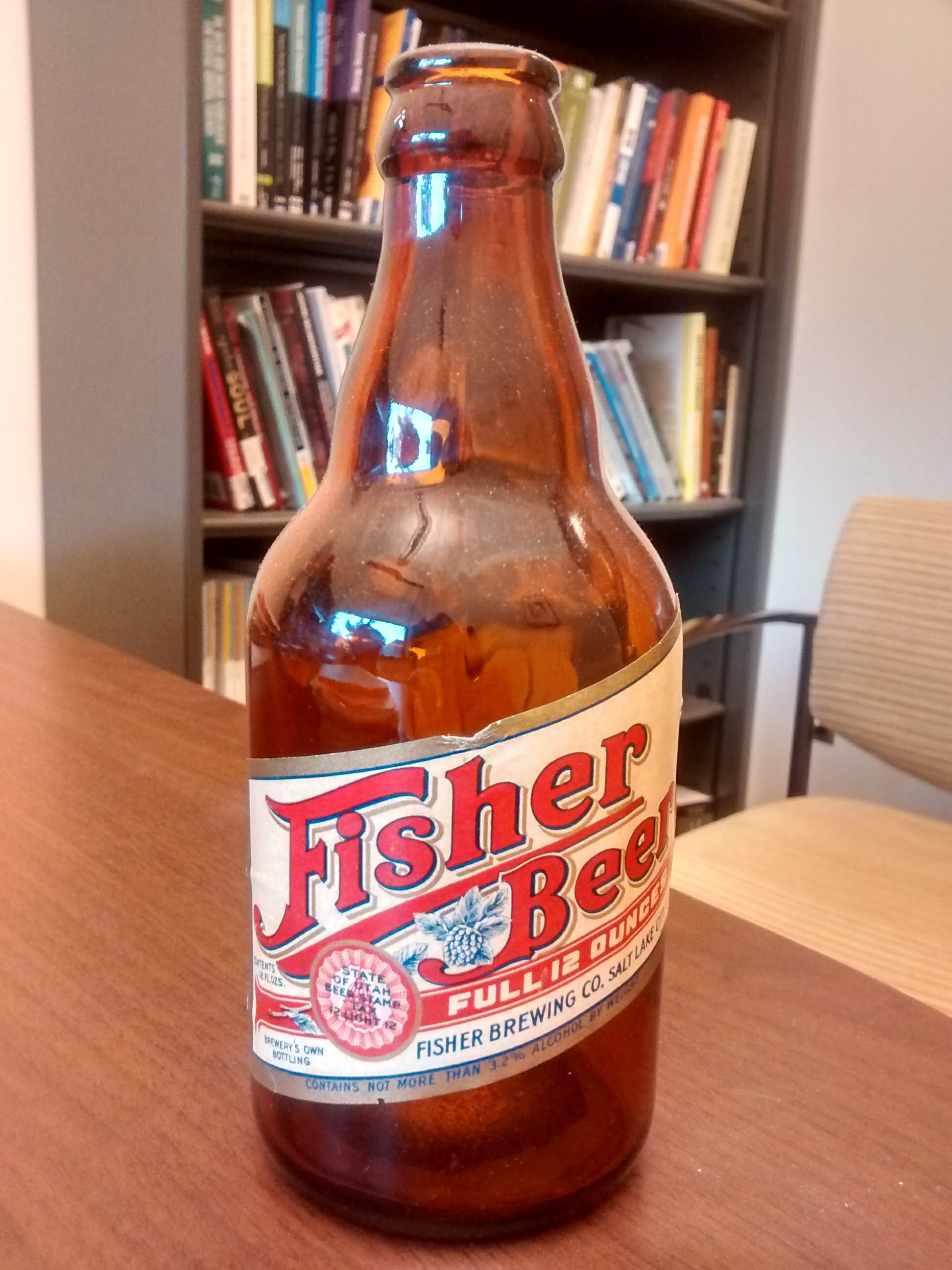 A picture of a beer bottle pulled from the attic: Fisher Beer.