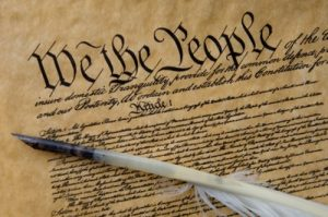 "historical document in tight cursive with ""We the People"" at the top"