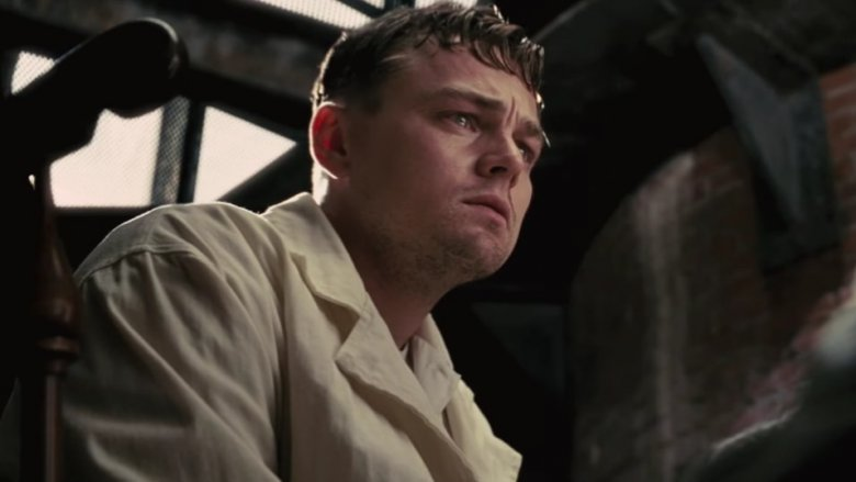 "Picture of Leonardo DiCaprio in the movie ""Shutter Island."" He has a worried, intense stare."