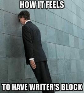 """a man in a suit presses his head against a wall with words reading, """"How it feels to have writer's block"""""""